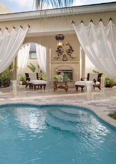 Everyone loves luxury swimming pool designs, aren't they? We love to watch luxurious swimming pool pictures because they are very pleasing to our eyes. Now, check out these luxury swimming pool designs. Outdoor Rooms, Outdoor Living, Outdoor Curtains, Deck Curtains, Outdoor Lounge, Hanging Drapes, Privacy Curtains, Outdoor Privacy, Burlap Curtains