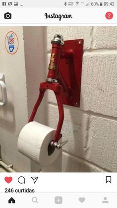 I would redesign this to be more practical. I don't like the bike fork so much as the idea that the toilet paper is never the wrong way. - i don't like I would redesign this to be more practical. I don't like the bike fork so much as the idea that the toi Car Part Furniture, Automotive Furniture, Automotive Decor, Diy Furniture, Metal Art Projects, Welding Projects, Diy Projects, Scrap Metal Art, Bicycle Art