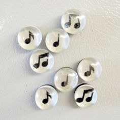 Super easy and fun craft idea. @Jess Lindgren - I'm sure you know where to get the magnets and the glass.  I think this will be my first craft night idea.