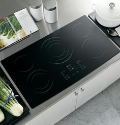 "GE 36"" Built-In CleanDesign Electric Cooktop Black PP975BMBB"