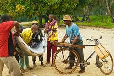 East Africa; Tanzania. A fishermen buying & selling fish at a fish market in Nungwi Village,Zanzibar Island