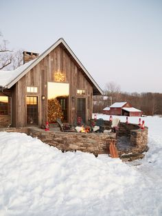 Attached Barn  ~   With reclaimed wood timbers & a lofted ceiling, it looks as inviting as the real thing; yet, thanks to modern trappings like radiant heat & durable engineered wood floors, it actually feels warm & cozy too.