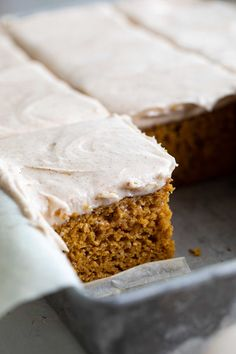 This moist pumpkin cake is filled with warm spices and is topped with a cream cheese frosting with a hint of cinnamon. This is the perfect fall dessert! #pumpkin #cake #baking #fall