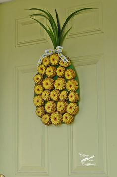 So easy to create this painted pine cone pineapple wreath!