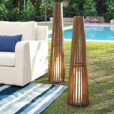 Our Pemberton Teak Floor Lamp is having a mod moment. This tall, slender lamp is all about moody, low light, radiated from a fiberglass resin diffuser nestled within. Naturally beautiful, naturally moisture-tolerant teak ribs are as outdoor-hardy as they are sculptural (best in a protected area to preserve integrity of electrical elements). Perfect poolside, or indoors, and even more gorgeous when grouped. Teak floor lamp Fiberglass resin d...