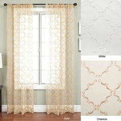 Add a touch of elegance to any room with this sheer polyester curtain panel. The stylish design allows light to easily filter through, creating a traditional trellis-embroidered organza look and enhancing the appearance of your window.