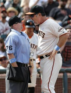 San Francisco Giants manager Bruce Bochy, right, argues with umpire Mike Muchlinski (76) after Juan Perez struck out against Colorado Rockies pitcher LaTroy Hawkins during the ninth inning of a baseball game in San Francisco, Sunday, June 15, 2014. Bochy was ejected by Muchlinski. The Rockies won 8-7. (AP Photo/Jeff Chiu)