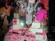 Vase filled with crystals, wish tree for people to attach good luck wishes to, cupcakes with ring toppers in martini glasses