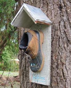 old shoe birdhouse..im pinning this because i thought it was funny!! FINALLY(maybe) a use for all of Chris' old work boots, that have no soles left on them, but we still keep them....hah ya!!
