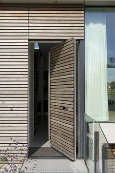 Slatted pivot door
