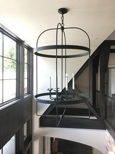 Infinity Vertical, custom sized for the two-story foyer.  Simple and stunning.