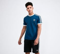 adidas Originals T-Shirt in Marine. Drawing inspiration from a classic baseball style, adidas hit a home run with vintage tones and an understated look. Eclipse T Shirt, Adidas Retro, Long Shorts, Sleeve Styles, Adidas Originals, Tommy Hilfiger, Stripes, Polo, Man Shop