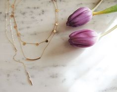 Talking all about the layering necklaces trend with @annika.bella the blog! Link in bio  #blog #blogger #blogpost #etsy #etsyshop #custom #jewelry #jewelryaddict #tips #layeringnecklaces #gold #tulips #immtribe #blogbffs #blogsociety #tnchustler #ffbht #l4l #potd #inspo #instablog #instapic by dailydoseofdesign