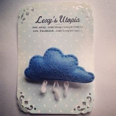 Super cute little rain cloud felt brooch with safety fastener and totally handmade by me :) in my little sewing room in Shropshire. Measures roughly