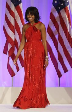 First Lady Michelle Obama debuted a gorgeous red gown by designer Jason Wu as she joined her husband at the Commander-in-Chief Ball, 2013. She wore the ruby-colored chiffon and velvet dress, a handmade diamond-embellished ring by jewelry designer Kimberly McDonald, Michelle Obama was also wearing bangles by Kimberly MacDonald for ForeverMark Diamonds, and Jimmy Choo shoes. The dress is now in the the National Archives.