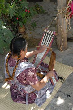 Oaxaca Weaver  Weaving cotton on the backstrap loom in Santo Tomas Jalieza Oaxaca Mexico