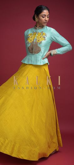 Buy Online from the link below. We ship worldwide (Free Shipping over US$100)  Click Anywhere to Tag Mustard-Yellow-Skirt-In-Raw-Silk-And-Mint-Blue-Peplum-Top-With-Embroidered-Flower-Pot-Motif-Online-Kalki-Fashion