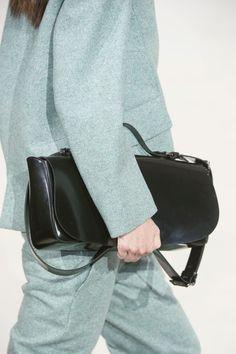 Jil Sander | minimal | 2 piece suit | black leather handbag |
