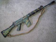 FN FAL with Rhodesian style camo paint job. SO MUCH WIN