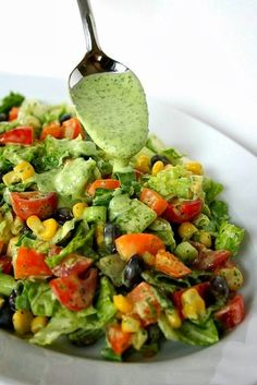 100 gramm - 103.91 calories Preparation: 1. To make the sauce. In a food processor mix the cilantro, avocado, yogurt, lime juice, garlic, olive oil, wine vinegar, salt, to obtain a homogeneous mass. Adjust the taste. 2. Finely chop Romaine, bell pepper, tomatoes, and green onions. 3.