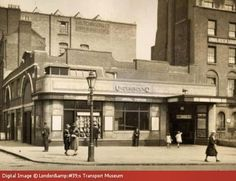 Street scene outside Angel station 1926. The station was opened on the City & South London Railway in 1901. The line later became the Northern line, part of London Underground. It was redesigned between 1922 and 1924.