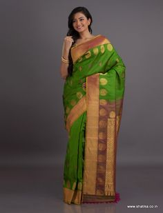 The gold unadorned zari is contrasted beautifully with a heavily ornate zari pallu and big gold motifs on the border of this pure Gadwal silk saree. Gadwal sarees are renowned for admirable zari patterns and well-crafted pure silk kuttu borders and pallus. Exhibiting a remarkable trait of getting folded down to the size of a matchbox, our Gadwal Silk Sarees online have demand throughout the country.