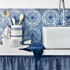 """lovely blue and white tiny check cabinet curtain matches Mexican tile backsplash. Link: """"40 Awesome Kitchen Backsplash Ideas"""""""