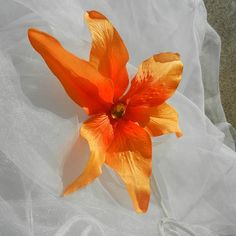 Orange Hawaiin Orchid Hair Clip by beautifulswagstore on Etsy, $5.00