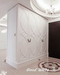 American molding design by GoodWare Décor | At the entrance, use the flexible moldings to create the geometric patterns on the cabinets. You can feel the lively atmosphere when you step into the entrance. The circular ceiling design focuses the lights of crystal lighting.