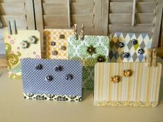 I've made magnet boards with fabric but never thought to use paper! This is cute!
