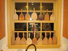 Butter paddles displayed on window.