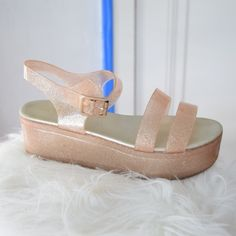 """Aldo Glitter Jelly Platform Sandals Beautiful Aldo heels in pink glitter jelly material with platform heel and ankle strap. Marked as size 7.5, but I am an 8 and they fit great! Good pre-owned condition. 2.5"""" heel. ALDO Shoes Platforms"""