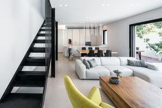 Completed in 2016 in Giv'atayim, Israel. Images by Uzi Porat    . An existing single-story, semi-detached house from the 1950's was remodeled and added a second story to accommodate a family of five.   The house,...