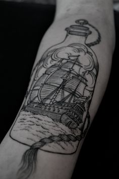 Ship sailing in a bottle woodcut illustration-style tattoo