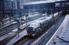 D6722 (later 37022, 37512, 37608) and D6704 at Liverpool St Station in 1962. Note the 'Gresley' coaches. D6722 was built at the English Electric Vulcan Foundry and delivered on 13th July 1961. Named 'Thornaby Demon' from 13th May 1987 till 1995. In 2014 still in active service as 37608 as part of the DRS Nuclear fleet.