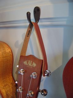 Golf Clubs Repurposed Image of Leather Ukulele Hanger Ukulele Stand, Ukulele Art, Ukulele Chords, Banjo, Ukulele Wall Mount, Guitar Storage, Small Guitar, Guitar Hanger, Cigar Box Guitar