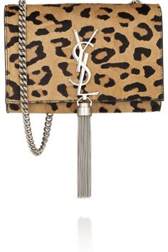 Saint Laurent's 'Monogramme' shoulder bag is a sophisticated way to incorporate leopard-print into any look. Crafted from soft calf hair and smooth black leather, this compact design has just enough room for a cell phone, compact and keys – use the pocket for your cards. It's finished with the label's iconic interlocking 'YSL' logo and a playful tassel. Shop it now at NET-A-PORTER.COM #SaintLaurent