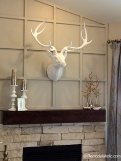 Fireplace wall treatment and ceramic deer