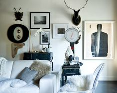 the three frames between the O and the antlers work as a small group of 3   houzz