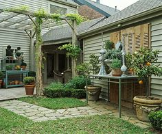 You can't even see the eyesore that this family had to landscape around! Click through for more brilliant landscaping: http://www.bhg.com/gardening/landscaping-projects/landscape-basics/backyard-landscaping-ideas/?socsrc=bhgpin072414landscapearoundaneyesore&page=3