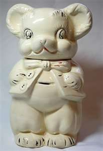 American Bisque Co. - Turnabout Bear Cookie Jar  I have this cookie jar.  For as long as I can remember, it sat on my Grandmother's freezer. After they both died, it was the one thing that I wanted the most.  It sits in my kitchen (along with other vintage kitchen tools from Grammy's own kitchen) today.