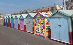 Hove beach huts - including the brightly painted number 71: the owner was in trouble for painting the hut so brightly as there are restrictions on what colours they can be painted as set by the council.