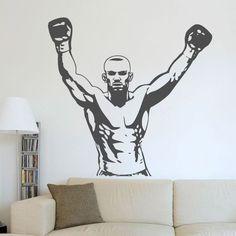 O vinil decorativo boxeador transforma os ambientes onde é aplicado. Sugerimos que aplique este vinil autocolante de desporto num quarto juvenil ou numa sala de convívio
