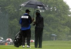 Tiger Woods in the heavy rain during the US Open Golf Championship.