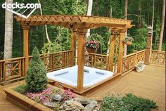 Harmonizing well with the wooded setting is this deck made of Wolmanized® Residential Outdoor® wood and featuring a spa, overhead sunscreen, built-in planter, railing panels, and patterned decking.