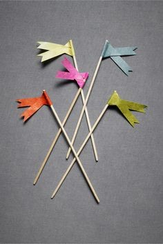 oh la la ... love these flags for cupcake toppers http://www.bhldn.com/the-shop_decor_the-naturalist/ribbon-tailed-pennants