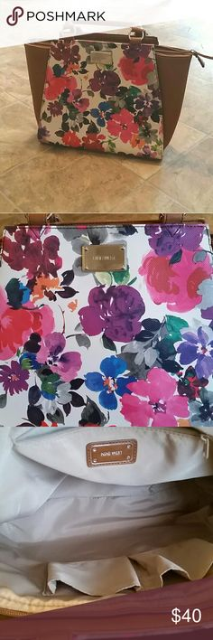 Nine West Floral Tote Bag This Nine West bag is almost in excellent condition. It just has minor pen marks inside the corner of the bag. The colors are beautiful! I just need different colors. I'm willing to trade for another floral bag. Nine West Bags