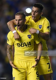 Dario Benedetto of Boca Juniors celebrates with teammate Cristian Pavon after scoring the first goal of his team during a match between Boca Juniors and Racing Club as part of the Superliga 2017/18 at Alberto J. Armando Stadium on November 19, 2017 in Buenos Aires, Argentina.