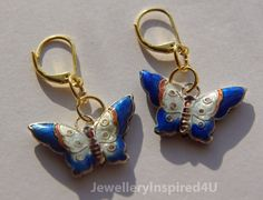 Cloisonne  Butterfly White and Cobalt Blue by JewelleryInspired4U.  These retail for $25.00 with current promotion spent $50.00 receive free shipping.