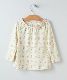 Flowers falling every which way and an embroidered bow up top for extra style! This floral print top was conceived in the spirit of spring and features a partially-gathered neckline and wide hemline for a wonderful shape that makes her look all grown up! A Hallmark Baby exclusive.